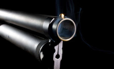 Smoke that is coming from a shotgun barrel photo