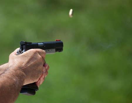 Brass blurring as it races away from a handgun just been shot