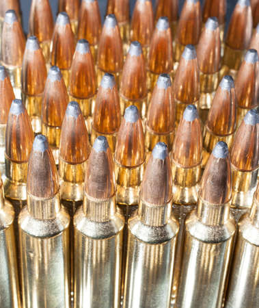 high powered: Tall bullets that go into a high powered rifle