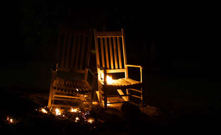 cinders: Two rocking chairs that are just beginning to burn