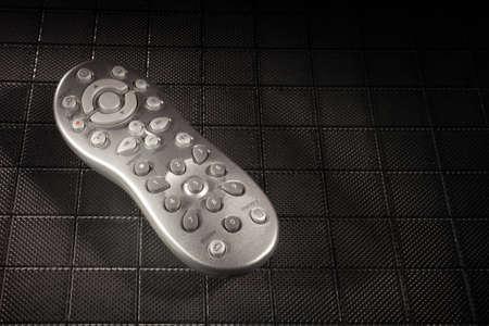 テクスチャ背景のリモコンを探している銀 写真素材