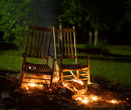 cinders: White rocking chairs that have been added to a fire