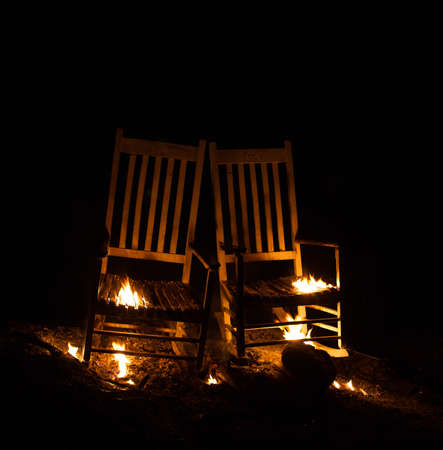 cinders: Pair of rocking chairs that are barely burning