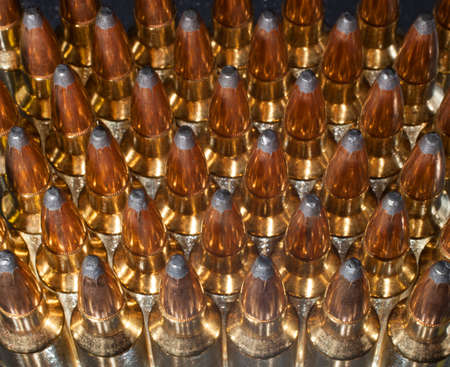 high powered: Shiny and reflective ammunition for a high powered rifle Stock Photo