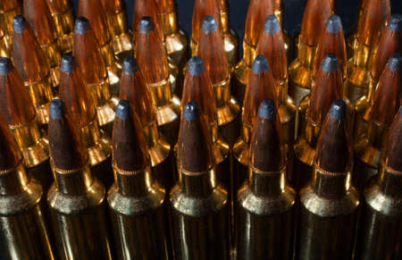 meant: Cartridges lined up that are meant to go into a rifle Stock Photo