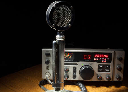 Two way radio on a table with an old metal microphone