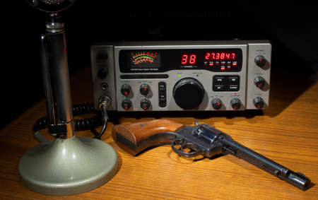 cb: Old microphone with a CB radio and a revolver