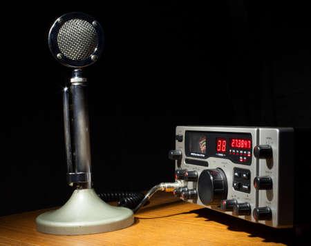 cb: Sideband CB radio that has an old metal microphone