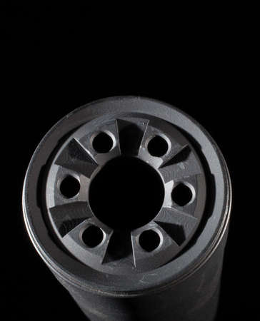Front side of a suppressor with a black background
