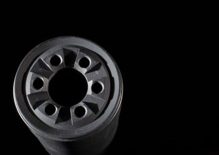 Front side of a suppressor with a dark background