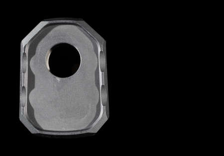 suppressor: Front side of a suppressor with a black background