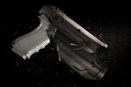 Polymer funda pistola que se hace para hacer cumplir la ley Foto de archivo - 30443373