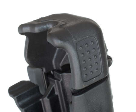 Hood that protects the back of a handgun and lever to release it