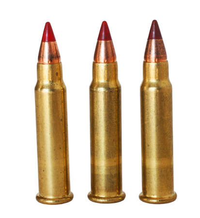 Three shells that are seventeen caliber on a white background