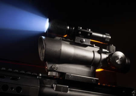 Scope designed for a rifle with a laser and flashlight