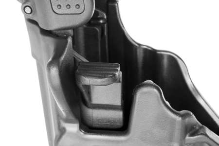 Button that is pushed on a polymer holster to release the handgun