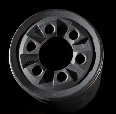 the silencer: Front end of a silencer with rim lighting and black background Stock Photo