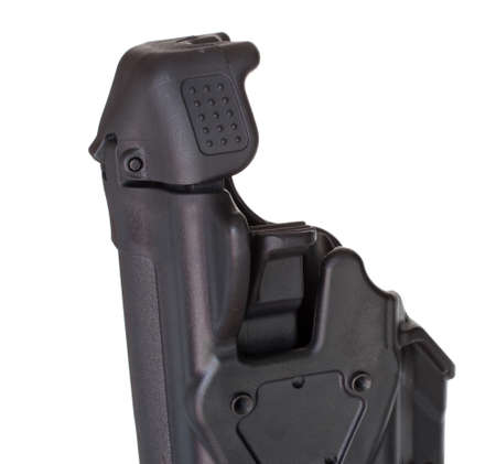 holster: Retaining hood and release lever on an isolated polymer holster Stock Photo