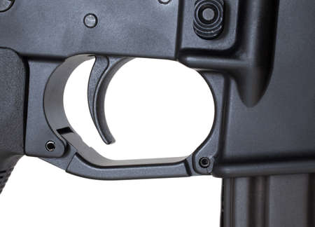 Metal trigger that is on an assault rifle isolated on white