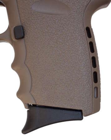 grip: Pistol grip on a semi automatic handgun isolated on white Stock Photo