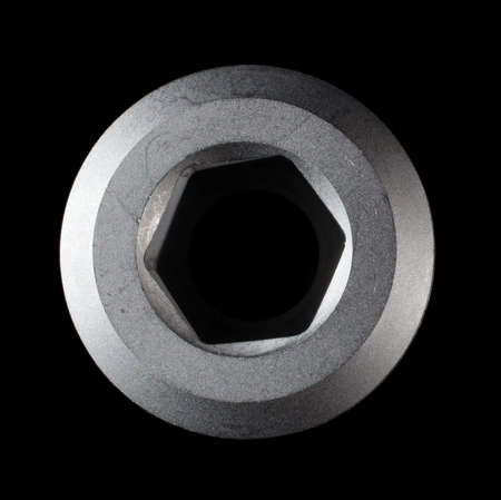 Side of a modern suppressor pointed toward the target