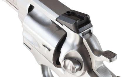 notch: Black notch to sight at the back of a revolver Stock Photo