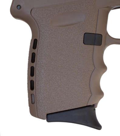 grip: Pistol grip on a brown polymer handgun isolated on white