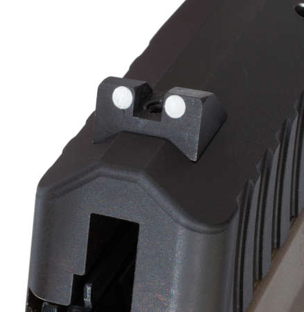 semi automatic: Two dot rear sight that is on the back of a semi automatic pistol Stock Photo