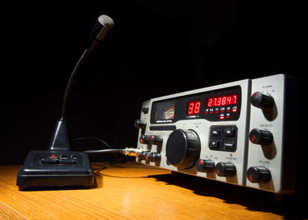 Two way radio and microphone that are on desk photo