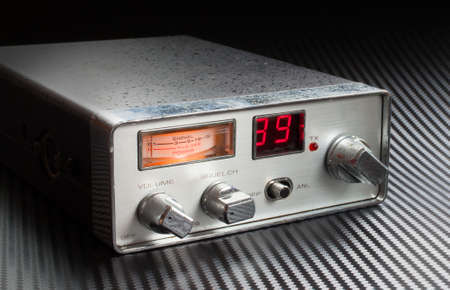 squelch: Two way radio that is powered up and on a graphite background