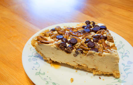 chocolate chips: Cheescake with nuts and chocolate chips on the top