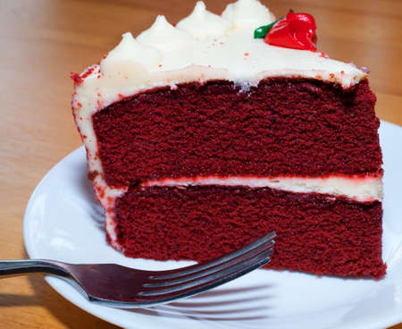 Red velvet cake on a plate with a fork Stock Photo