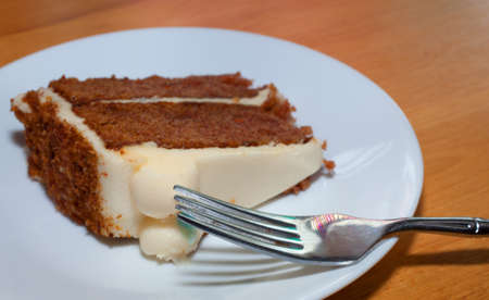 carrot cake: Fork on a plate with a slice of carrot cake