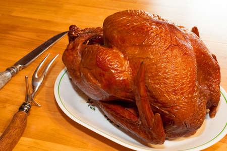 Smoked turkey on the table and ready to cut