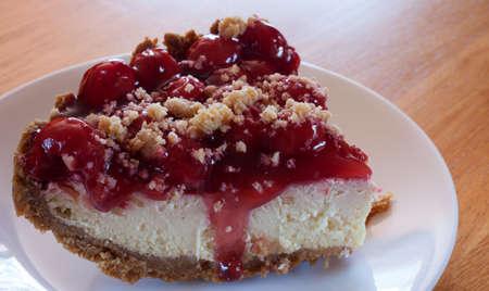 graham: Cheesecake with cherry topping and graham cracker crust Stock Photo