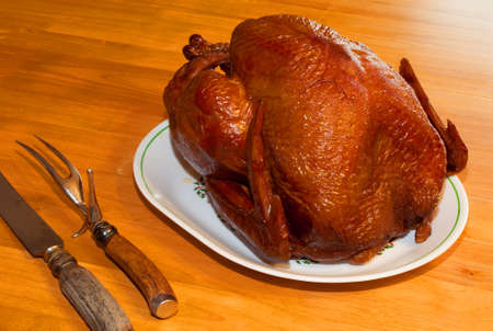 Smoked turkey on the table waiting to be carved