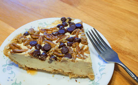 chocolate chips: Nuts and chocolate chips on top of a cheesecake