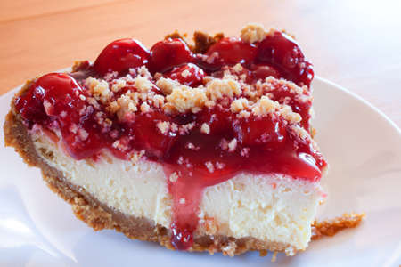 graham: Cheesecake with a graham cracker crust and cherry topping Stock Photo