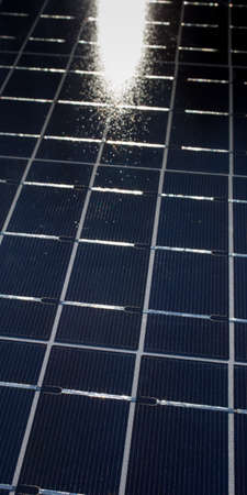 photons: Solar panel collecting photons and generating energy