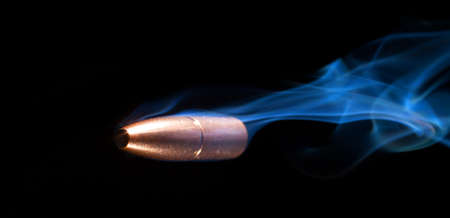 Smoking bullet flying from right to left by the camera