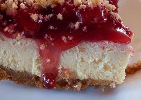 graham: Cheesecake with graham cracker crust and cherries up close