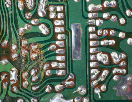 Old circuit board that shows signs of wear and over heating Stock Photo