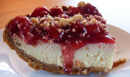 graham: Slice of cheesecake with graham cracker crust and cherries
