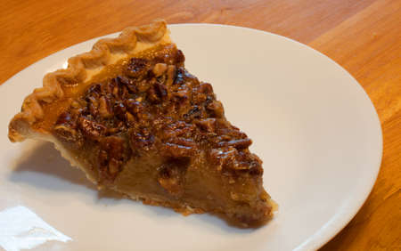 Pecan pie on a white plate ready to eat Banco de Imagens