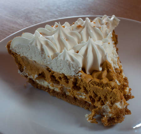 pumpkin pie: Pumpkin pie with whipping ready to eat during the night