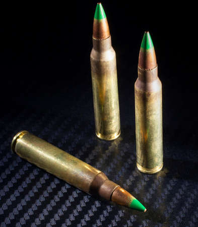 tipped: Three green tipped cartridges considered to be armor piercing