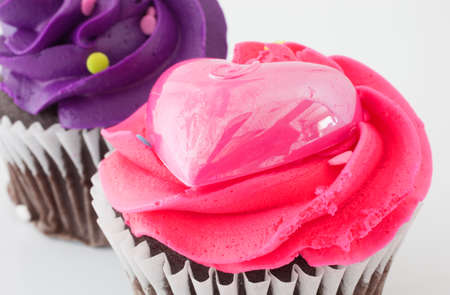 Chocolate cupcakes with purple and pink frosting photo