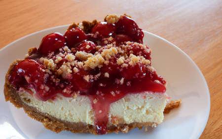 graham: Slice of cheesecake with cherry topping and graham cracker crust Stock Photo