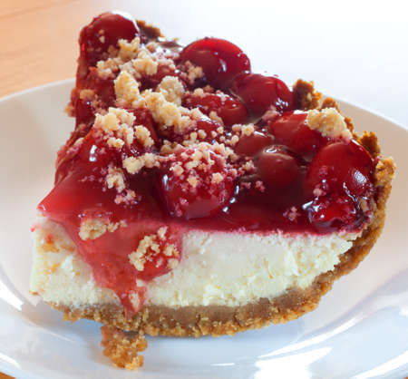 graham: Thick piece of cheesecake with cherries and graham cracker crust
