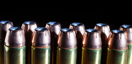 magnum: Cartridges for a forty four magnum handgun with hollow point bullets
